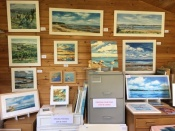 interior of Becky Samuelson's art studio and Isle of Wight paintings for sale.